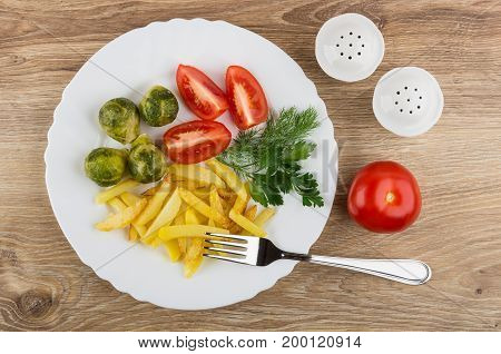 Dish With Fried Potatoes, Tomatoes, Brussels Sprouts, Greens, Salt, Pepper