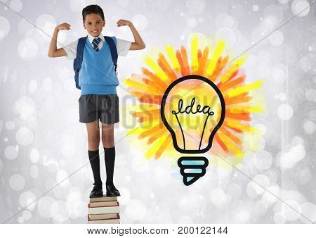 Digital composite of Schoolboy standing on book tower with colorful light bulb idea graphics