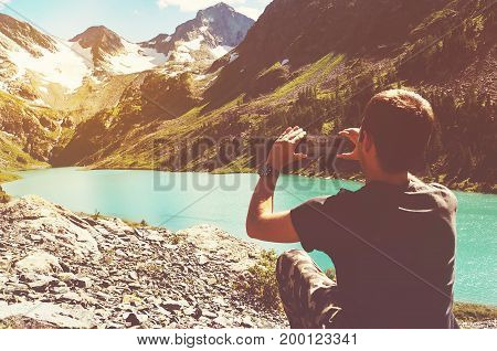 Tourist Man Taking Picture With Her Smartphone