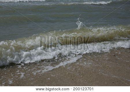 waves on the shore of the Sea of Azov beach. Waves run to the seashore