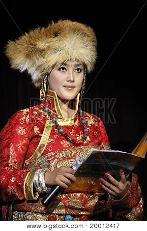 Tibetan ethnic dancer performs on stage