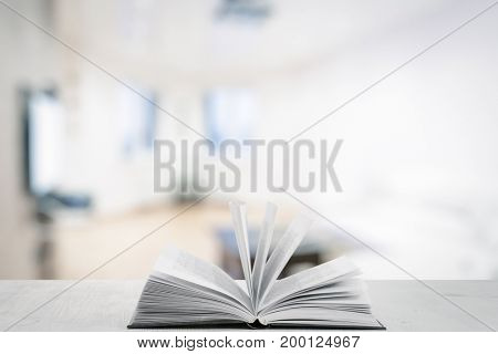 open book on white wooden table in the living room