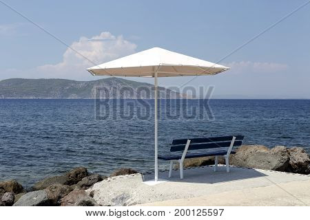 The seascape, benches and sun umbrellas on the beach