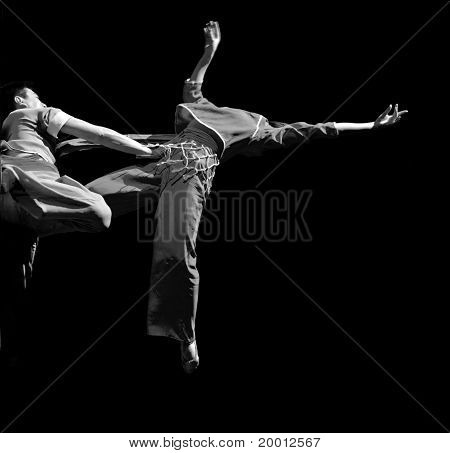 chinese dancers perform modern duo dance on stage