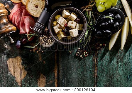 Tasty appetizing italian Mediterranean Food Ingredients Flat Lay on Green Old Rustic Background Top View Copy Space Above