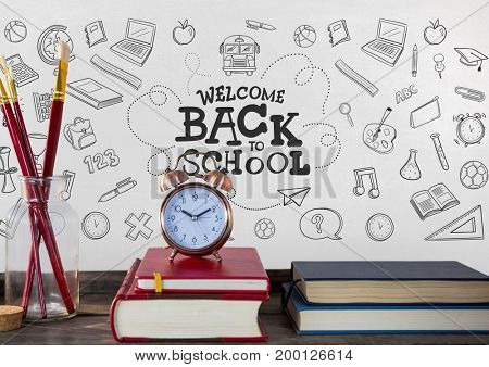 Digital composite of Books on the table against white blackboard with education graphics and back to school text