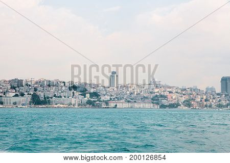 Beautiful view of the European part of Istanbul against the beautiful blue Bosphorus and sky. The modern Istanbul.