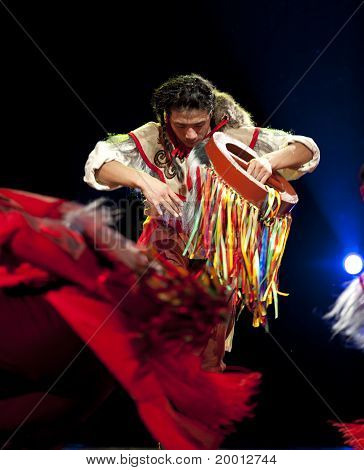 chinese Qiang ethnic dancer performs on stage