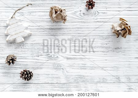 Christmas decoration on grey wooden background top view.
