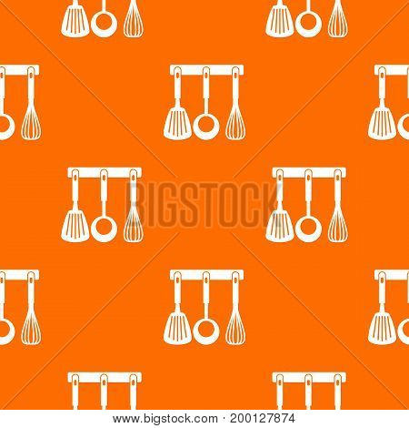 Spatula, ladle and whisk, kitchen tools on a hanger pattern repeat seamless in orange color for any design. Vector geometric illustration
