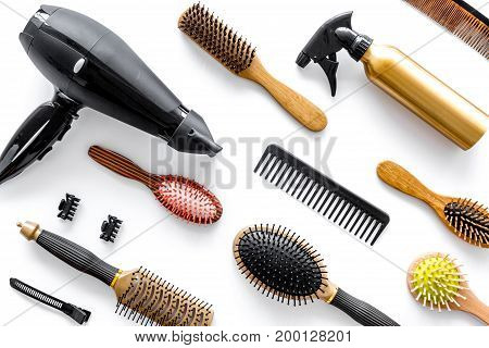 Combs and hairdresser tools in beauty salon on white background top view.