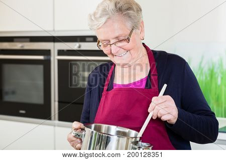 Grandma cooking comfort food in her kitchen