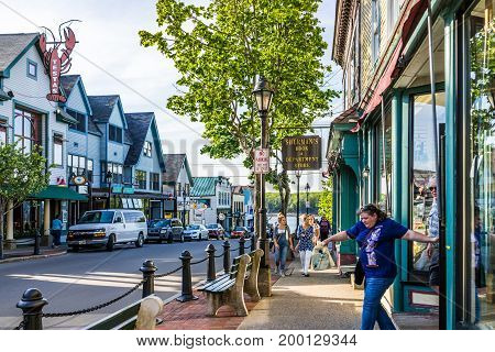 Bar Harbor USA - June 8 2017: Old local independent bookstore called Sherman's exterior in downtown village on vacation in summer with signs and people walking