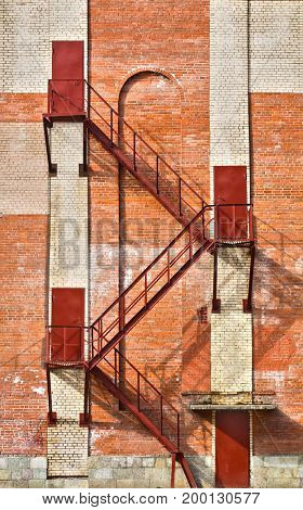 steel staircase and doors on old brick wall