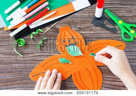 Create A Gift Box Of Halloween Pumpkin. The Child Cuts Out The Details Of The Application Of The Box