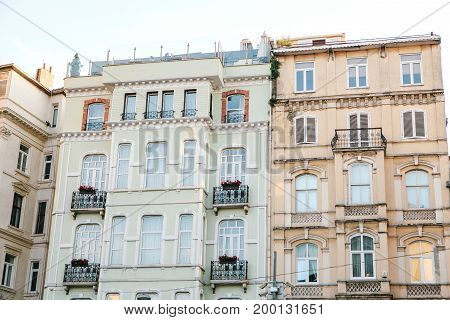 Daytime vew of old city multistory building facades.