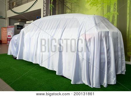 Voronezh, Russia - June 04, 2017: New car hidden under the cover before the premiere