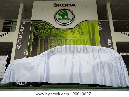 Voronezh, Russia - June 04, 2017: New Skoda car under the cover at the presentation of the model