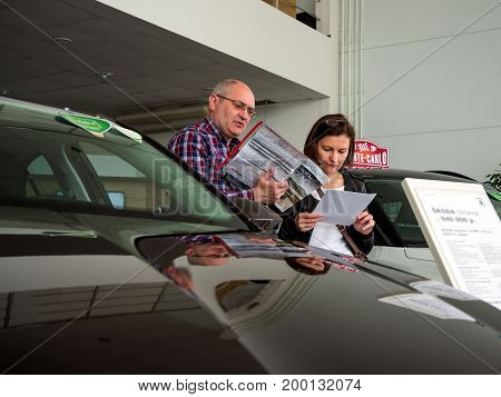 Voronezh, Russia - June 04, 2017: Visitors to the car dealership learn price lists for new cars
