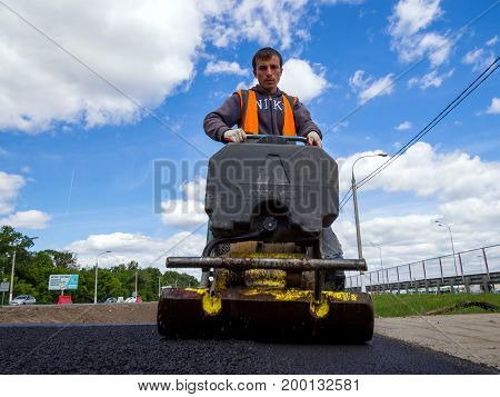 Voronezh, Russia - June 04, 2017: Trimming the asphalt with a vibrating machine