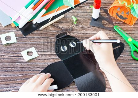 Create A Gift Box Black Cat Halloween. The Child Draws Details Of The Application Of The Box. Childr