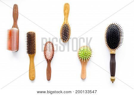 Set of combs in beauty salon on white background top view.