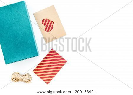 To wrap gift. Box, kraft paper, envelope, greeting card, on white background top view