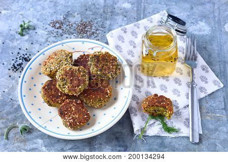 Kale bites with breadcrumbs and sesame seeds.