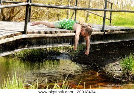 Girl Playing On Bridge