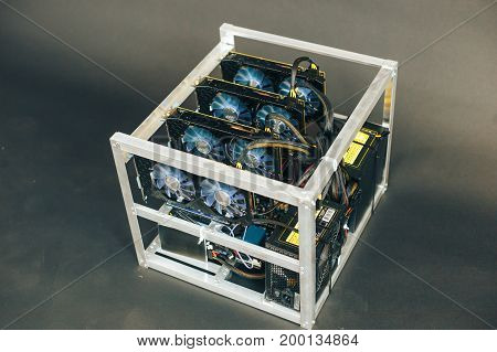 System for the crypto currency. Video cards in the folded box. Farm on a black background