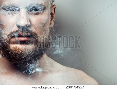 Portrait Of Strained Focused Adult Man With A Scar On His Face In Cigarette Smoke. Bad Habit Concept