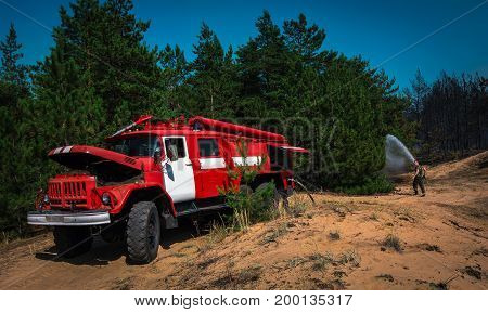 fire truck to put out a forest fire. firefighters to extinguish the fire. wildfire
