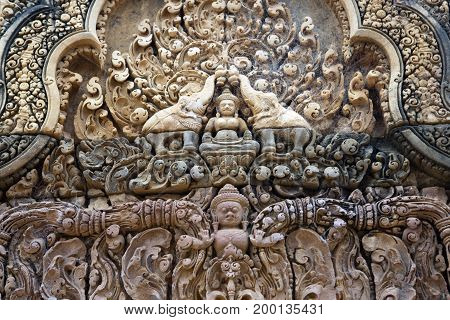 Cambodia. Siem Reap. Carved stone patterns on temple walls Banteay Srey (Xth Century)