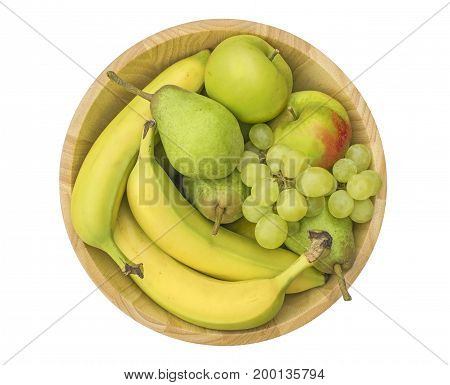 Group of healthy fresh fruit in a wooden bowl isolated on a white background
