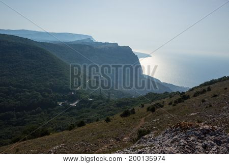Mountain landscape. View of the sea and the green mountains in the Crimea.