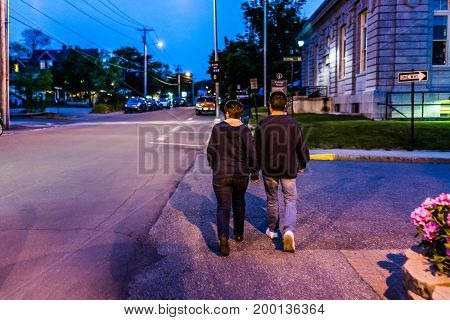 Bar Harbor USA - June 8 2017: Couple walking on street in downtown village during evening night
