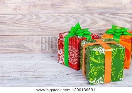Christmas gift boxes on wooden table with snow. With copy space
