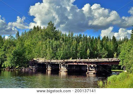 Old wooden bridge across the river Chirko-Kem. Karelia, Russia