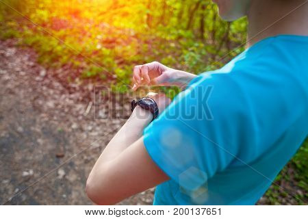 The Athlete Looks At His Watch.