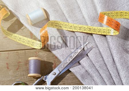 Grey Suit Fabric samples, vintage scissors and needles. Tailor staff backdrop