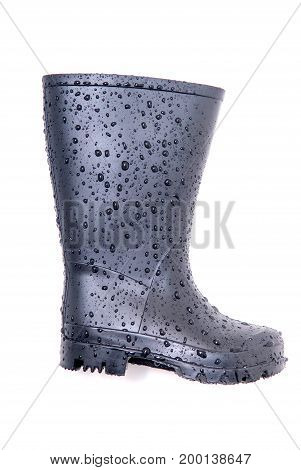black wellington boot with water droplets isolated