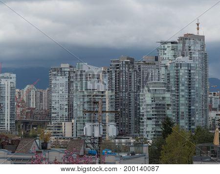 Highrise buildings cranes cityscape Vancouver Canada April 2017