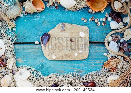 Summer Vacation Relaxation Background Theme With Seashells, Fishing Net, Hat, Rope, Stones And Weath
