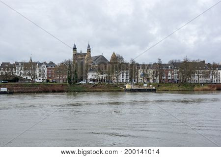 MAASTRICHT NETHERLANDS - FEBRUARY 20 2016: Embankment of the Meuse river in the historical center of Maastricht a city and a municipality in the southeast of the Netherlands