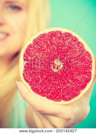 Woman Holds Grapefruit Citrus Fruit In Hand