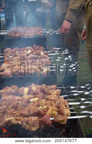 Grilled Kebab Cooking On Metal Skewer. Roasted Meat Cooked At Barbecue.traditional Eastern Dish, Shi