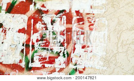 Creative Vintage Background. Old Wall With Remnants Of Paint, Paper Ads, Cracks Or Scratches. As Bac