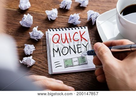 Man Drawing Quick Money Concept In Notepad