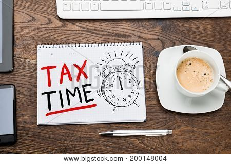 Tax Time Concept In Notepad At Desk