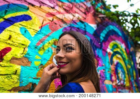 Pretty brunette woman in colorful abstract background